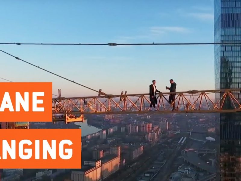 Daredevils Hang Off Crane on Skyscraper   Death Defying