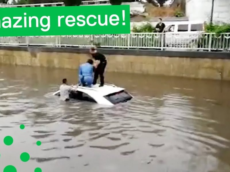 Woman Rescued from Submerged Car